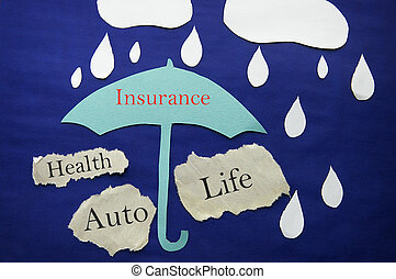 paper umbrella and rain with insurance themed messages