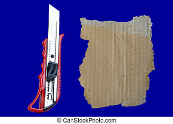 Paper knife and old cardboard