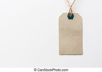 Paper label with rope on white background. Sale in modern design. Minimal concept. Flat lay, top view, mockup, template, copy space for text, overhead