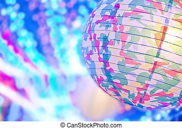 paper lamp shade on bokeh muticlor background