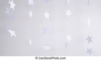 Paper magic stars hanging and rotating decoration on a white background. Christmas concept. slow motion. 3840x2160