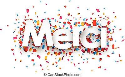 Paper merci confetti sign. - White merci sign over confetti...