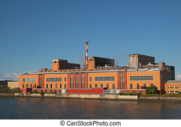 Paper mill building on the river bank