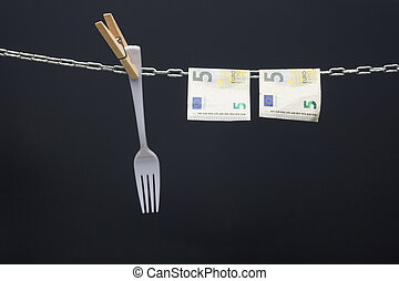 Money held in a chain or hung on a chain; paper money legal tender; Euros, currency of the European economic community, Common market.