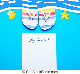 photo of sheet of paper My Vacation and colorful sandals on hte wonderful blue studio background