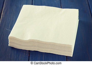 paper napkin on blue wooden background