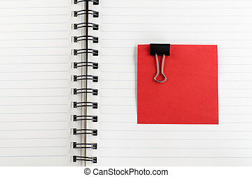 paper note with clip on notebook