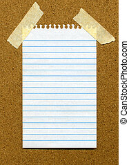 Paper on noticeboard. - White lined blank paper stuck to a...