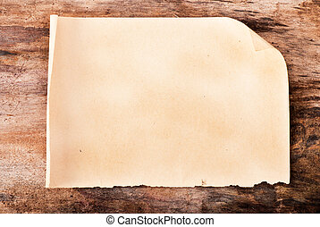 Paper on old wooden background