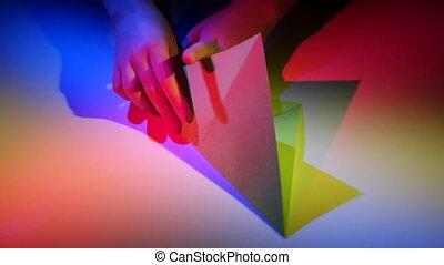 Paper origami rocket. White. Time lapse. Closeup - Paper...
