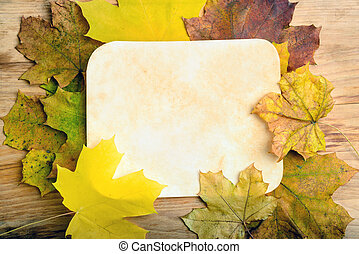 paper page on fall leaves