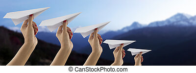 Paper plane holding by hand on Everest mountain view blur ...