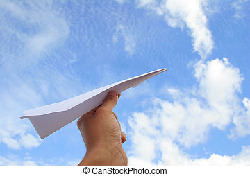 Hand launching paper plane
