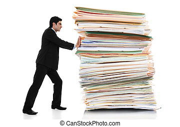 Paper Pusher - Stock image of businessman pushing a giant...