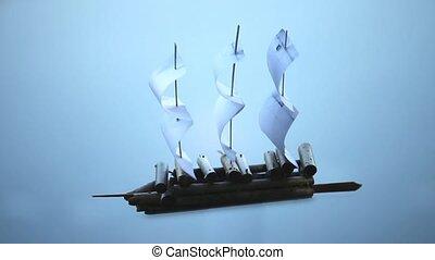 Paper Sailing ship on a blue backgr - Sailing ship...