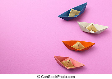 Paper ship on pink background