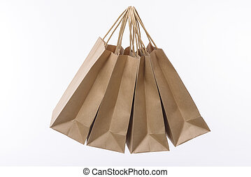 Paper shopping bags on white background - Variety of colored...