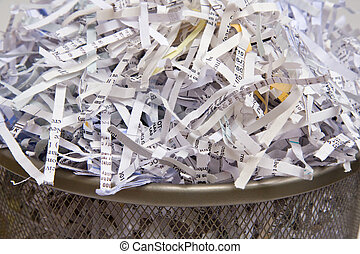 Paper Shredded - Closeup of shredded paper in a wastebasket.