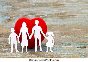 Paper silhouette of family and heart on wooden background. Health insurance concept with copy space