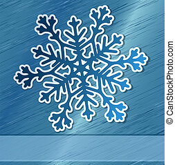 Paper snowflake over steel background