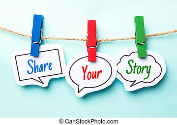 Paper speech bubbles with text Share Your Story hanging on the line.