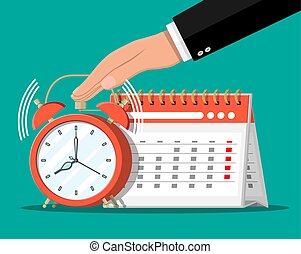 Paper spiral wall calendar, clocks and hand. Calendar and ...