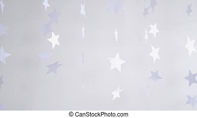 Paper stars hanging and rotating decoration on a white background. slow motion. Christmas concept. 3840x2160