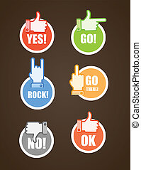Paper stickers of different color hand gestures