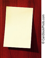 Paper sticky note on wall