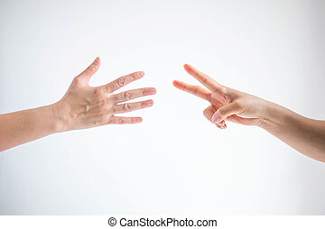 Paper symbol and scissors symbol in playing rock paper scissors game on white background.