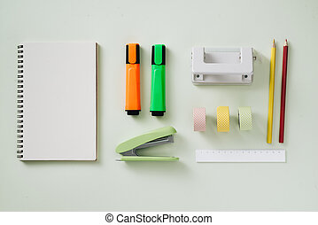 Paper tape roll, paper clips, and notepads laying on a wooden table, School supplies, Office supplies, Back to school