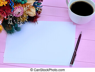 Paper with coffee cup and dried flowers