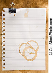 Paper with coffee stains and clip - Paper from a notepad...