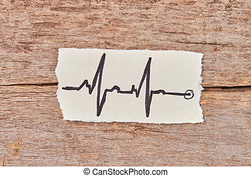 Paper with image of heart impulses.