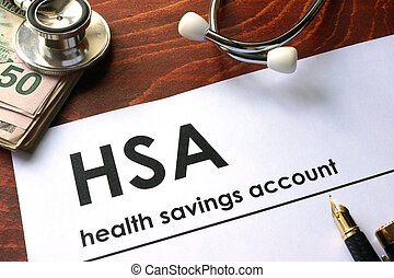 health savings account (HSA) - Paper with words health...