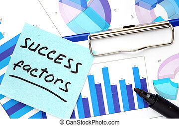 Paper with words success factors and graphs. Business concept.