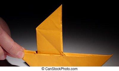 Paper yellow origami boat. Closeup - Paper yellow origami...