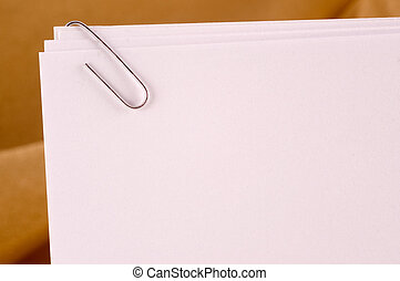 Paperclip - Sheets of paper fastened in the corner with a...