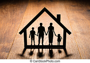 Papercut Of House With Family In It