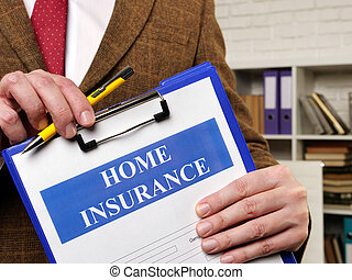 Papers about Home insurance claim and pen for filling out.