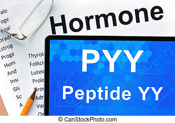 peptide YY (PYY) - Papers with hormones list and tablet with...
