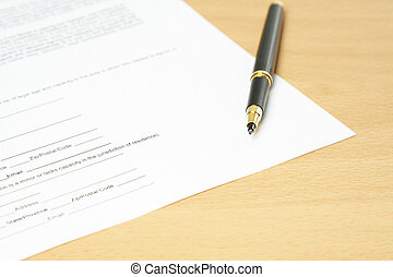 Paperwork - A shot of a paperwork with a pen on a desk