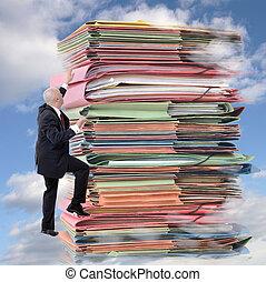 Paperwork climbing - businessman climbing pile of endless...