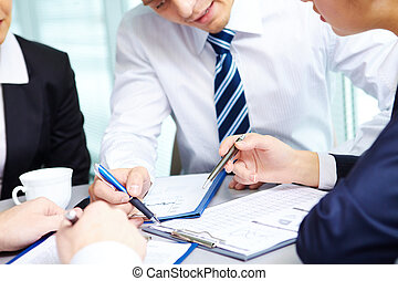 Paperwork - Image of human hands during discussion of...