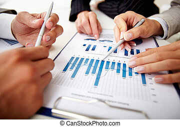 Paperwork - Image of human hands with pens over business...
