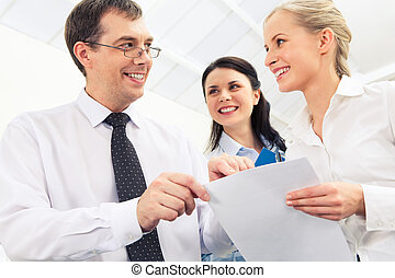 Paperwork - Portrait of business team working with papers in...