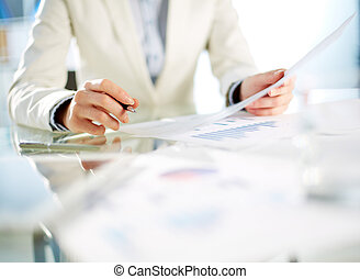 Paperwork - Hands of young businesswoman working with papers