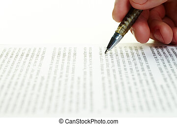 Paperwork - Close-up of human hand holding metallic pen over...