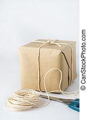 papier brun, ficelle, attaché, paquet