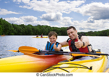 pappa och son, avnjut, kayaking